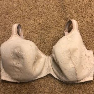 One beige bra by Cacique in size 42H